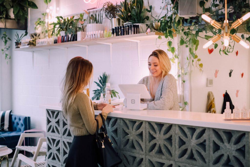 two women, cashier, checkout